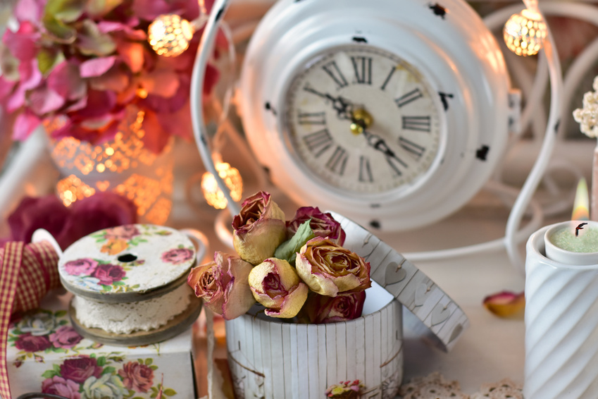 shabby chic style home decoration with old clock ,bunch of dried roses and lace trim