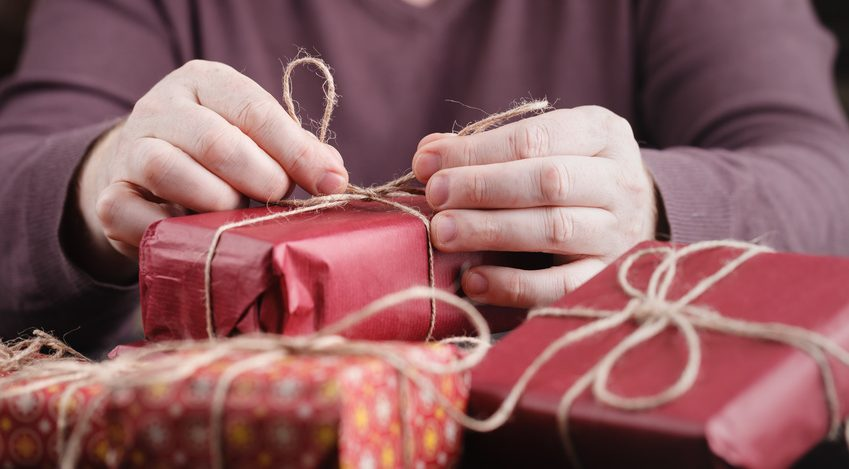 man opening presents