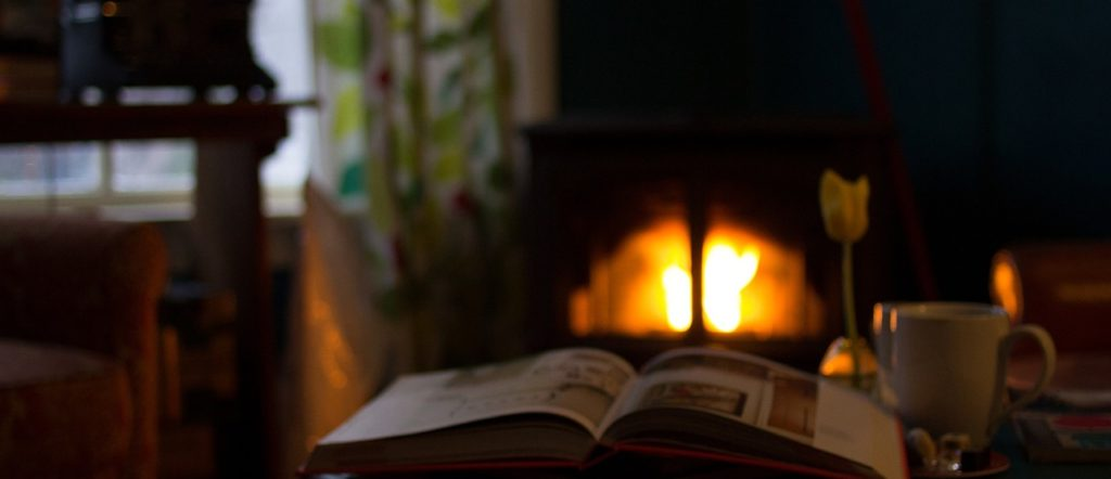 by the fireplace image