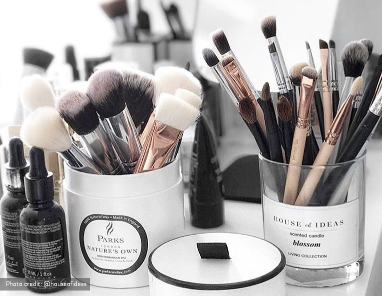 Re-use your candle jar to hold make-up brushes.